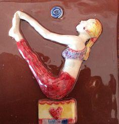 Ceramic tile with yoga figure