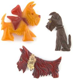 Three vintage Bakelite Scotty dog brooches auctioned in Feb. 2012 for a private collector. Pre-auction value for the set was estimated at nine hundred to twelve hundred dollars. Love, love, LOVE the Scotty with the red bow!/what i have a scottie Dog Jewelry, Animal Jewelry, Jewellery Box, Jewelry Accessories, Fine Jewelry, Vintage Buttons, Vintage Brooches, Vintage Costume Jewelry, Vintage Costumes