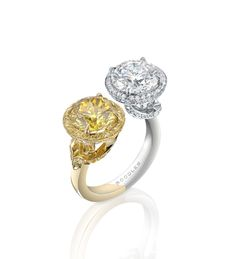 Gemini Diamond Ring. New design in platinum and 18ct yellow gold - An exceptional, elegant ring from Boodles, featuring a 3.08ct natural fancy vivid yellow round-brilliant cut diamond and a 3.01ct white round-brilliant cut diamond, colour F, clarity VVS1 in platinum and 18ct yellow gold.