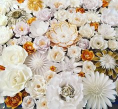 A personal favorite from my Etsy shop https://www.etsy.com/listing/238668738/custom-handmade-paper-flower-wall