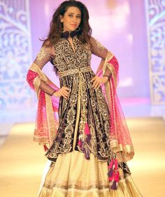 Karisma Kapoor walks the ramp with Indian attire