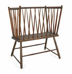 "Realized Price: $ 1185    Pennsylvania rodback Windsor cradle, ca. 1815, retaining an old varnished surface, 33 3/4"" h., 28"" w., 17 1/2"" d."