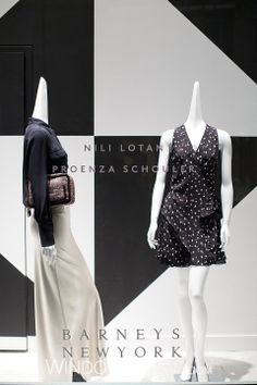 Shop the Barneys, Los Angeles, The Grove window on WindowsWear.  Black and white is prooving to be the colourway of choice for windows around the globe this month. Barneys continues the trend, placing soft silks against a background comprised of a strong graphic checkerboard. A fluid satin maxi skirt paired with a classic silk shirt by Nili Lotan stand aside a flirty tiered ostrich print dress from Proenza Schouler, both looks offering a sense of softness for the new season.