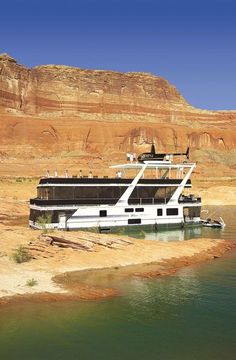 What goes perfect with a houseboat? Why, a helicopter of course!