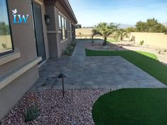 You don't have to have just one material in your back or side yard. Combinations of turf and pavers can add depth to your space, helping to avoid a monotonous feel. Add in pathway and area lights and you've got a perfect space to use at night.