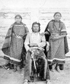 Blackfoot man and his two wives - circa 1879
