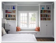 built-ins and window seat around a window for more storage space by cherie