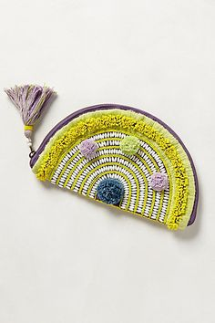 Anthropologie pouch purse with pom poms and tassel