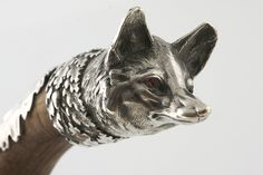 Late Victorian silver fox walking stick with garnet eyes - not technically steampunk but I don't have a suitable board at the moment.