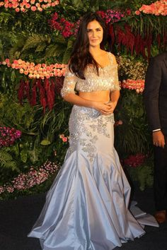Katrina Kaif at Virat Kohli-Anushka Sharma Wedding Reception : Here's another Manish Malhotra piece that I wish I liked (because the color is pretty) but unfortunately, I find the material and embroidery/embellishments too tacky. Indian Bridal Fashion, Indian Fashion Dresses, Indian Designer Outfits, Indian Outfits, Designer Dresses, Anushka Sharma, Priyanka Chopra, Kohli Anushka, Bridal Outfits