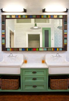 green bathroom vanity with wash sinks. Love the sinks, however the vanity is not to scale, mirror seems at odds with everything else.