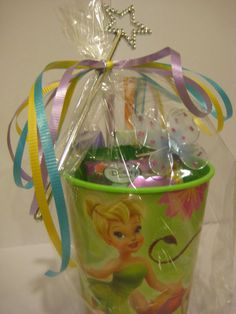 party favors - Tinkerbelle cup full of candy, all in cellophane bag, tied a fairy's wand with curly ribbons. Birthday Party Centerpieces, Fairy Birthday Party, Kid Party Favors, 4th Birthday Parties, 2nd Birthday, Princess Birthday, Craft Party, Birthday Ideas, Tinkerbell Party Theme