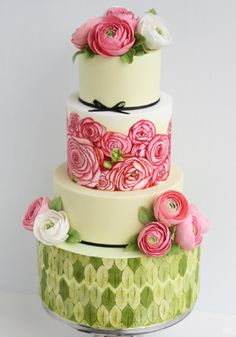 Hand-painted green and pink ranunculus wedding cake