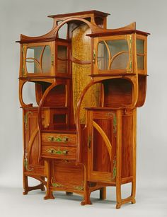 A Cabinet-Vitrine from 1899 by Belgian architect and furniture designer Gustave…