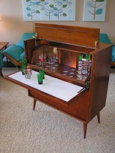 I have this bar in blonde...Danish Modern Bar Credenza...just ntcd i have the couch too but mine needs to be recovered