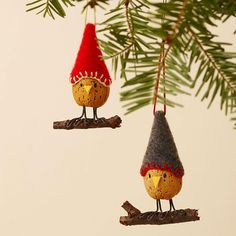 Make an Almond Bird Christmas Ornament    Small whole almond in shell   Clear spray shellac   Drill and 1/16-inch drill bit   Felt: red or gray   Embroidery floss: red, dark green, or ivory   Tapestry needle   Polyester fiberfill   Black crafts wire: 18-gauge   Needle-nose pliers   1-1/2-inch-long twig   Hot-glue gun and glue sticks   Crafts glue   Cardstock: yellow   Puff paint: black