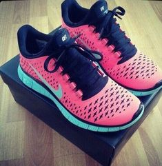 Pink and sky blue running shoes