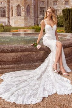 Our stunning sheath wedding dress has combination Chantilly lace and cotton lace appliqués and is available with a knee high split at front. For a modern bride who wants to make a statement. Find a stockist near you and request an appointment. Slit Wedding Dress, Perfect Wedding Dress, Bridal Wedding Dresses, Wedding Themes, Wedding Bride, Ellis Bridal, Fit N Flare Dress, The Dress, Dress Collection