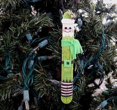 Popsicle Stick Elf - use a zigzag to make his outfit, then draw his stripey socks. Add a little garland trim to his hat along with his jingle bell. His belt buckle is a square, folded in half both ways to cut the inside square out.