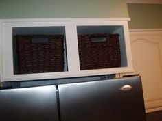 Cute idea! Take off cabinet doors and use baskets in hard-to-reach spots like over the fridge!