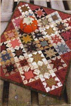 Primitive Folk Art Quilt Pattern:    PINCUSHION STARS. $7.50, via Etsy.