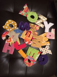 Quilted letters using scrap material.