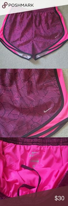 Nwot nike dri fit tempo running shorts sz m New without tags. Nike dri fit tempo printed  running shorts. Pink and black. Built in underwear. Drawstring. Size medium. Nike Shorts
