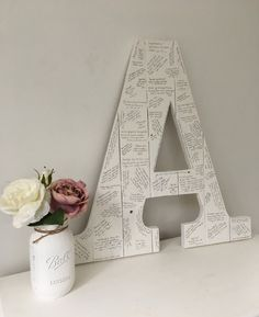 A personal favourite from my Etsy shop https://www.etsy.com/uk/listing/504321204/wedding-guest-book-letter-wedding-guest