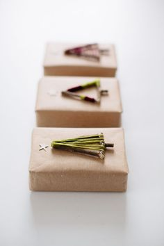 Make your own DIY Christmas tree gift toppers with twigs and string.