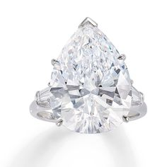 This ring is set with a pear-shaped 12.33 carat diamond. D color, internally flawless diamond.Platinum.Size 7.Estimate: $800,000 - $1,060,000. #phillips #auction #diamonds #neclace #phillipsjewels Diamond Jewelry, Diamond Earrings, Diamond Rings With Price, Quality Diamonds, Necklace Set, Diamond Engagement Rings, Antique Jewelry, Diamond Cuts, Jewels