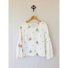 Long Sleeve Floral Blouse with PomPom Detailing by TaraLightCo, $155.00