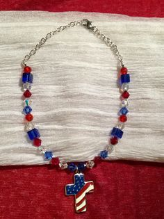 """Beautiful Flag colors for either male or female. Adjustable necklace for size Small-Medium 9-11"""" (can be made larger) Swarovski Crystal bicones in our Red White & Blue & center is a Flag charm 1x3/4"""" --2"""" chains on either side in silver with a silver lobster clasp finishes this FurBabies One of a Kind necklace $50.00"""