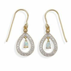 Plated Brass Fashion Earrings with Opal and Diamond Accents Silver Castle Jewelry. $20.74. 18 karat gold plated brass fashion french wire earrings with diamond accents and a 3mm x 5mm synthetic white opal drop. The earrings hang approximately 30mm.