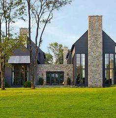 black exterior of contemporary house with tan brick