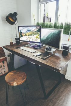 Rustic wood desk with wide workspace in studio office.