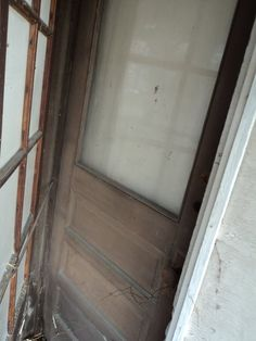 Original door! One of two! On the left, you can see a glass panel outer door...LOVE THIS!