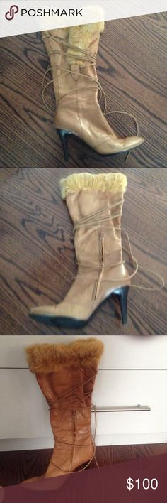 Nine West leather boots Lace up boot in camel color with fur trim.  Size 7 1/2.  Worn but in good condition Nine West Shoes Lace Up Boots