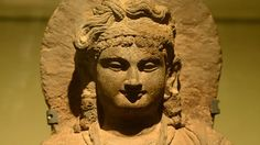 An ancient Buddha statue on display in Kabul museum in June 2013, following an extensive restoration process.