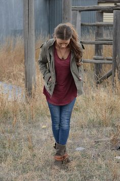 743. ponytail, pendant necklace, loose tee, jacket, worn jeans with boots