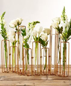 Inspired by the chemical revolution of French nobleman, Antoine-Laurent de Lavoisier, this vase set from Tozai Home is truly spectacular and unique. The test tube-shaped glass vases feature hinged pip