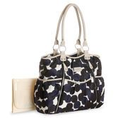 Bold polka dots, hidden pockets and an updated design make this diaper bag perfect for the modern mom. <br>