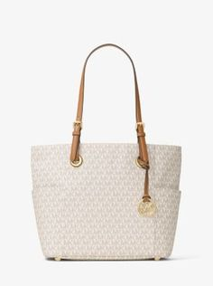 This classic carryall is just the ticket for on-the-go style. We created a spacious, streamlined shape in our signature logo print, adding leather top handles for luxe contrast. Interior pockets will keep small essentials organized, while the exterior slip pockets are perfect for spare sandals or an umbrella.