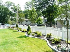 Vinyl Fence Installation and Tree and Shrub Plantings with Cobblestone Border | Yelp