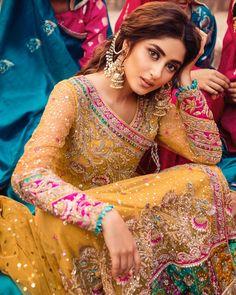 Yellow lehenga for mayoon or mehndi Pakistani Mehndi Dress, Bridal Mehndi Dresses, Pakistani Formal Dresses, Pakistani Wedding Outfits, Pakistani Bridal Dresses, Pakistani Wedding Dresses, Pakistani Dress Design, Bridal Outfits, Indian Dresses
