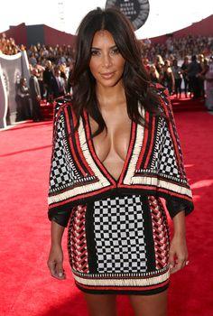 Kim Kardashian Cocktail Dress - Was this dress custom-made for Kim K?  Seems it... Kim Kardashian wore a Balmain dress with a plunging V-neckline and black heels to the 2014 VMAs.