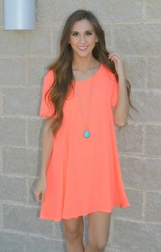 The perfect shift dress is here! The solid neon coral short sleeve chiffon dress is perfect for dressing up or dressing down!