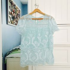 Beloved lace top Absolutely everyone compliments this shirt but I just don't love it myself. They definitely don't sell it anymore and I've never seen anyone else was if. I will ship it quickly. Vintage look Flying Tomato Tops Blouses