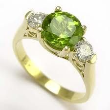 Gorgeous peridot and diamond ring set in 18k gold. Matthew and my birthstone (August).