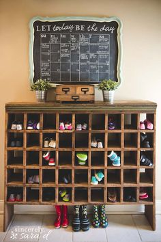 Great organization for a mudroom - shoe cubby made from an old mail sorter & chalkboard calendar.
