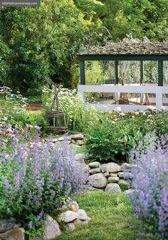 Rock wall raised beds...swoon!